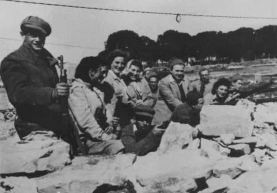 A group of men and women manning a guard post during the siege on Gush Etzion (Credit: The Historical Archives of Gush Etzion)