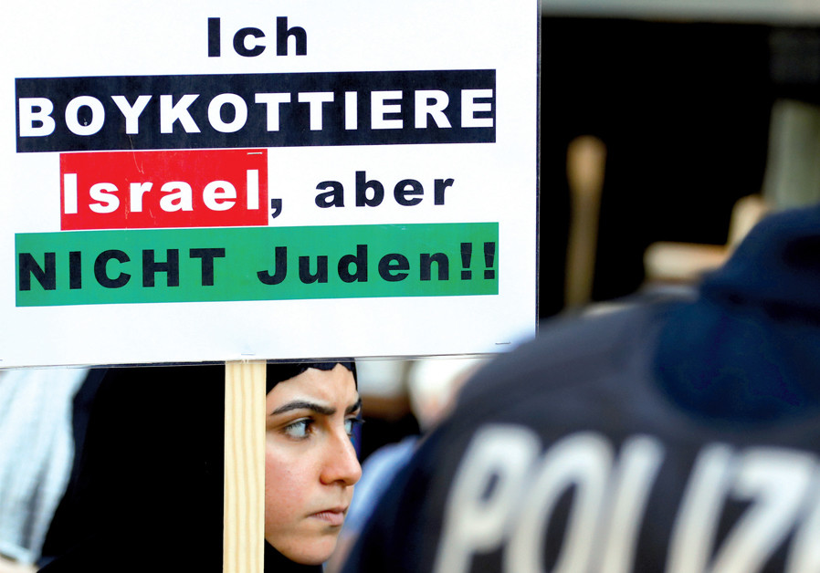 A protester holds a placard reading 'I boycott Israel, but not the Jews,' during a demonstration marking al-Quds Day (Jerusalem Day), in Berlin on June 1 (Credit: Fabrizio Bensch/Reuters)
