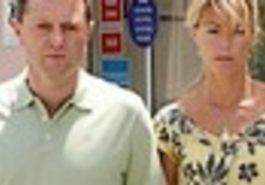 Madeleine's parents back in UK after being named suspects