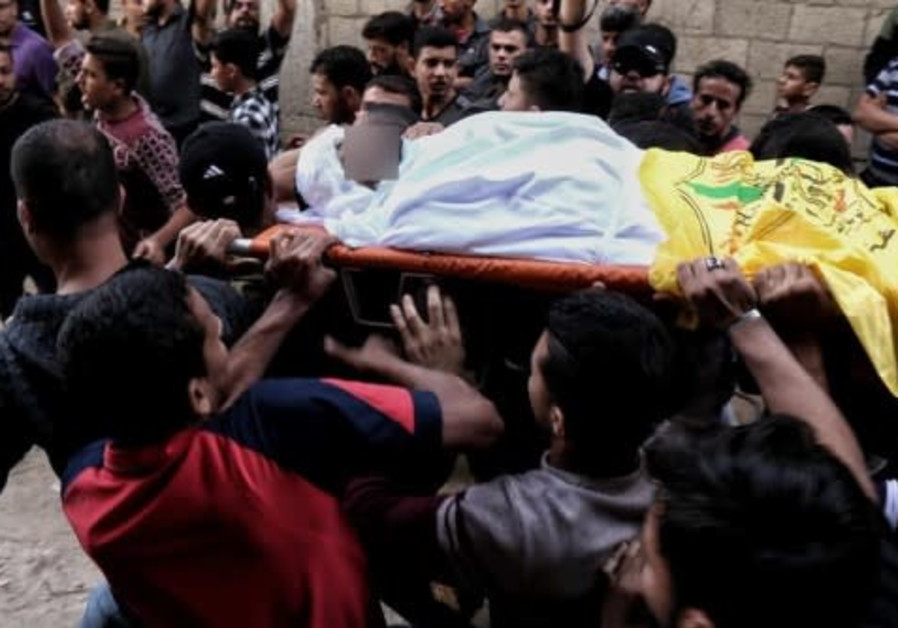 High alert in Israeli south as Palestinians attend mass funeral, protests
