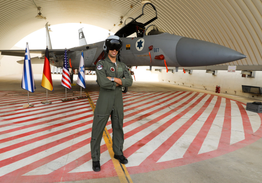 Capt. B stands in front of an F-15 IAF plane during the Blue Flag drill (Credit: Marc Israel Sellem/The Jerusalem Post)