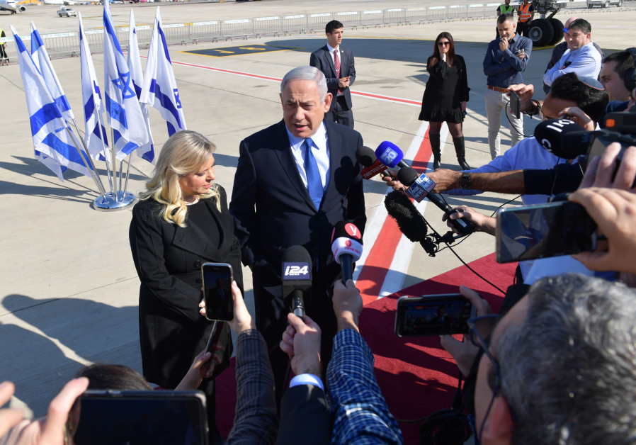 Prime Minister Benjamin Netanyahu and his wife Sara speak to the press before boarding the plane to Lisbon (Credit: Kobi Gideon/GPO)
