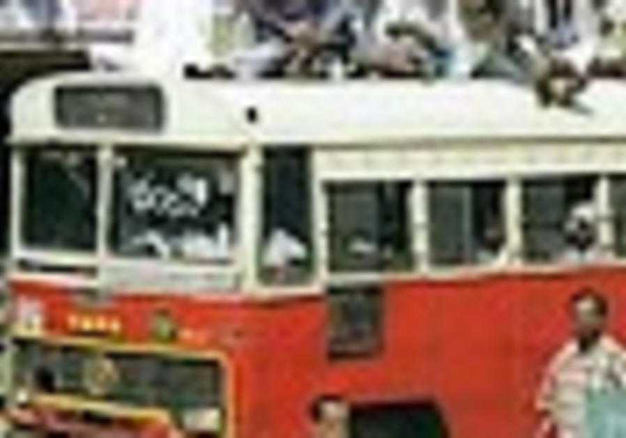 At least 18 dead as bus plunges into river in India