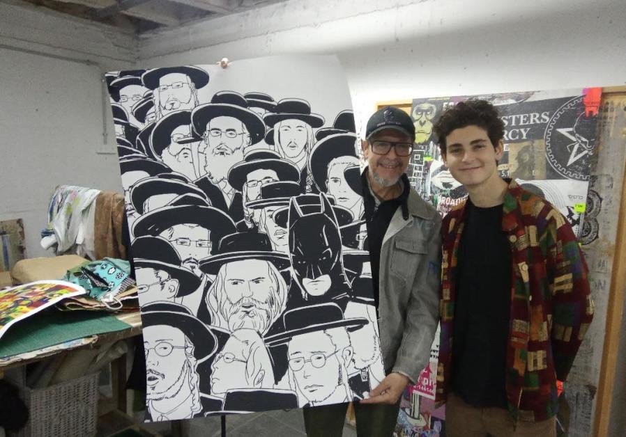 Actor David Mazouz [R] next to Art Director of the Link Hotel Daniel Siboni [L], the art depicts Batman as a Haredi man./ Hagay Hacohen