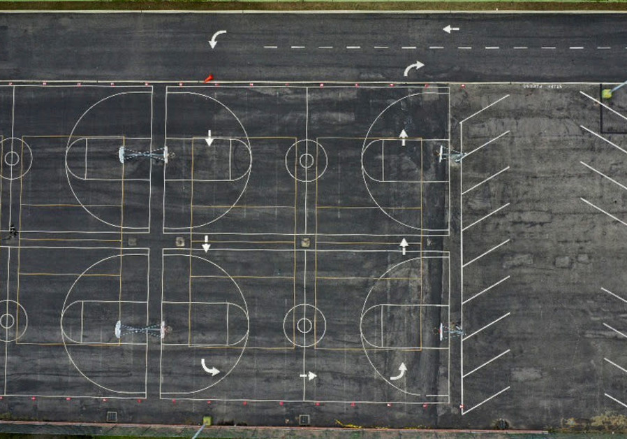 A general view of school basketball courts in Los Angeles the day after California issued a stay-at-home order due to coronavirus disease (COVID-19) in Los Angeles SOURCE LUCY NICHOLSON / REUTERS