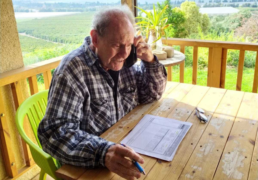 Holocaust survivor, Zvi Ortenberg, calling elderly people in Israel to remind them they are not forgotten (Credit: 2020 IFCJ)