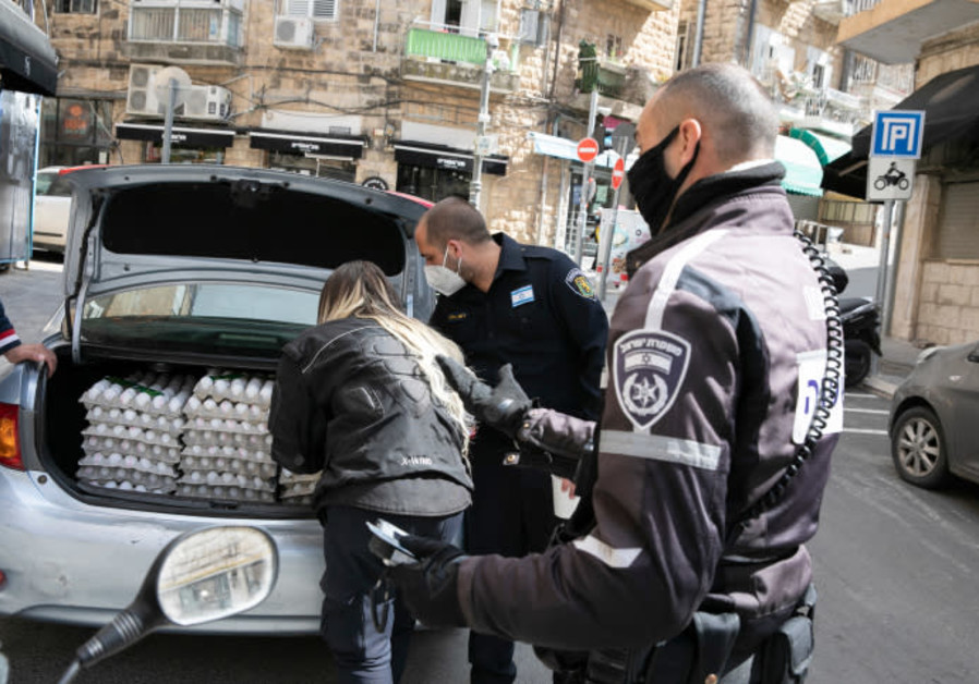 SIGNIFICANT DISRUPTIONS to global food supply chains have already been reported: An Israel Police officer and Jerusalem city workers check whether eggs were being sold on the black market on April 8. (Credit: Olivier Fitoussi/Flash90)