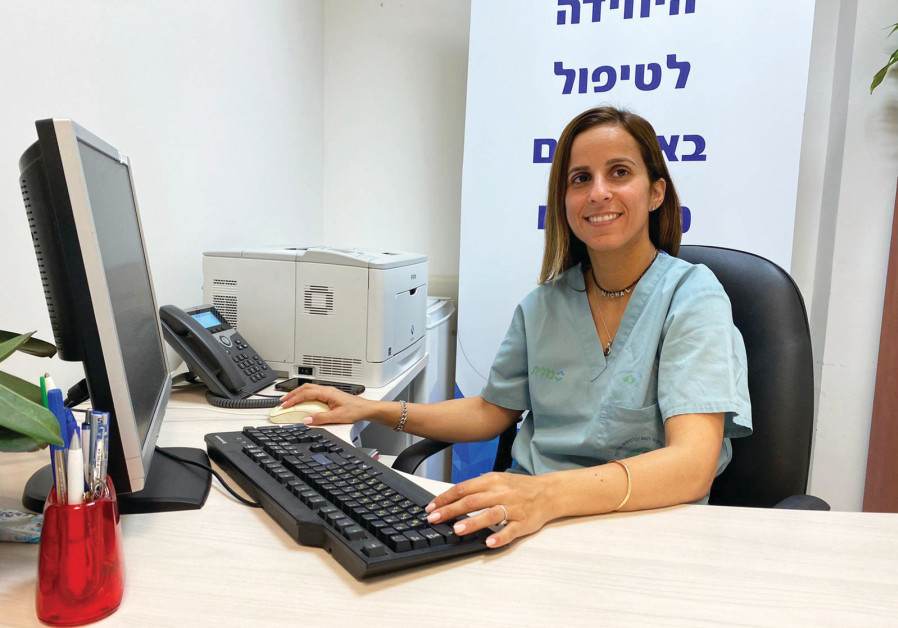 MICHAL RAZ-REUVENI, who was moved to Beersheba's Soroka Medical Center due to the epidemic, feels good about the work she is doing. (Credit: Soroka Medical Center Spokesman)