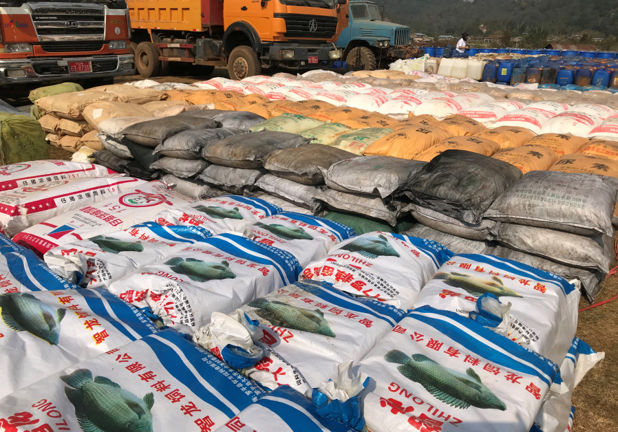 Undated handout photo of precursor chemicals used to make illicit drugs such as methamphetamine, ketamine, heroin and fentanyl seized by Myanmar police and military near Loikan village in Shan State. (Myanmar Police/UNODC/Handout via REUTERS)