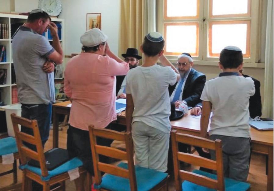 MICHAEL, ORLY and their two sons recite the Shema prayer before a Giyur K'Halacha conversion court (Credit: Giyur K'Halacha)
