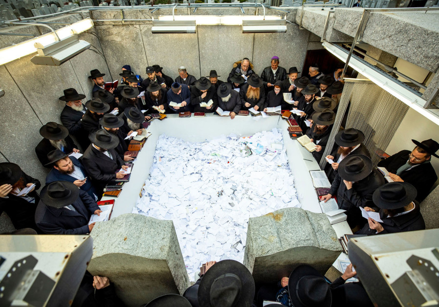 CHABAD RABBIS pay their respects at the Rebbe's resting place in November 2019.