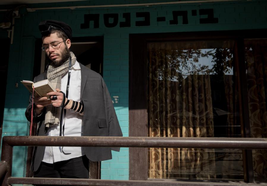 PRAYING OUTSIDE the Beit Chabad house in Kathmandu, Nepal. (Nati Shohat/Flash90)