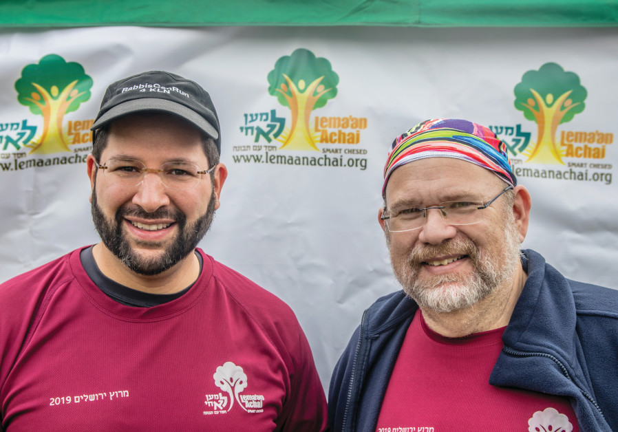 RABBI BINYAMIN MARWICK (left) flew in from the US to run in the Jerusalem Marathon on behalf of Lema'an Achai with Avrohom Leventhal.
