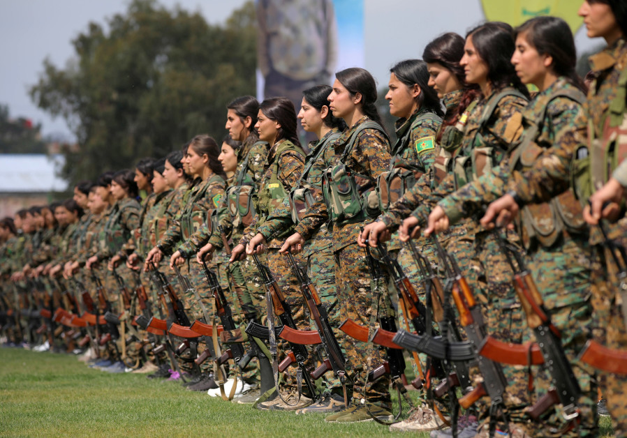 KURDISH FEMALE fighters of the Women's Protection Unit (YPJ) take part in a military parade as they celebrate victory over Islamic State, in Qamishli, Syria, in March 2019. (Rodi Said/Reuters)