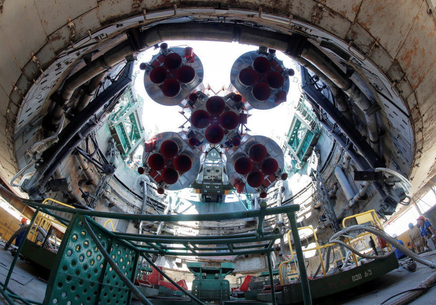 RUSSIA'S SOYUZ-FG booster rocket with the Soyuz MS-13 spacecraft for the new International Space Station crew, mounted at the launch pad at the Baikonur Cosmodrome, Kazakhstan, last July. (Dmitri Lovetsky/Pool via Reuters)