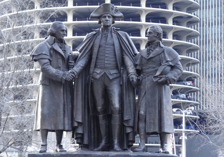 IN THIS memorial along the Chicago River, George Washington, in his Revolutionary War uniform, shakes hands with English-born Robert Morris on his right and Polish-Jewish emigrant Salomon on his left. Morris, a signer of the Declaration of Independence, and Salomon provided financial support to assure victory in the American Revolution. At the statue's base, a plaque envisions a multitude of people being welcomed by Liberty and her outstretched arms. (Spiterman/Flickr)