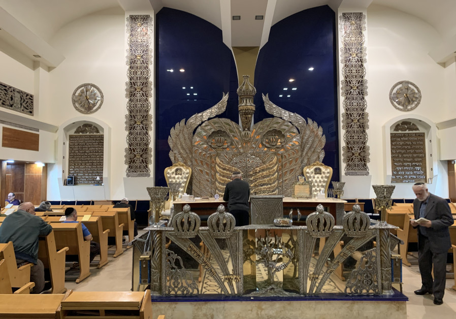 GUR Aryeh Synagogue interior. The magnificent gold- and silver-fronted ark can be seen faceing the congregation.