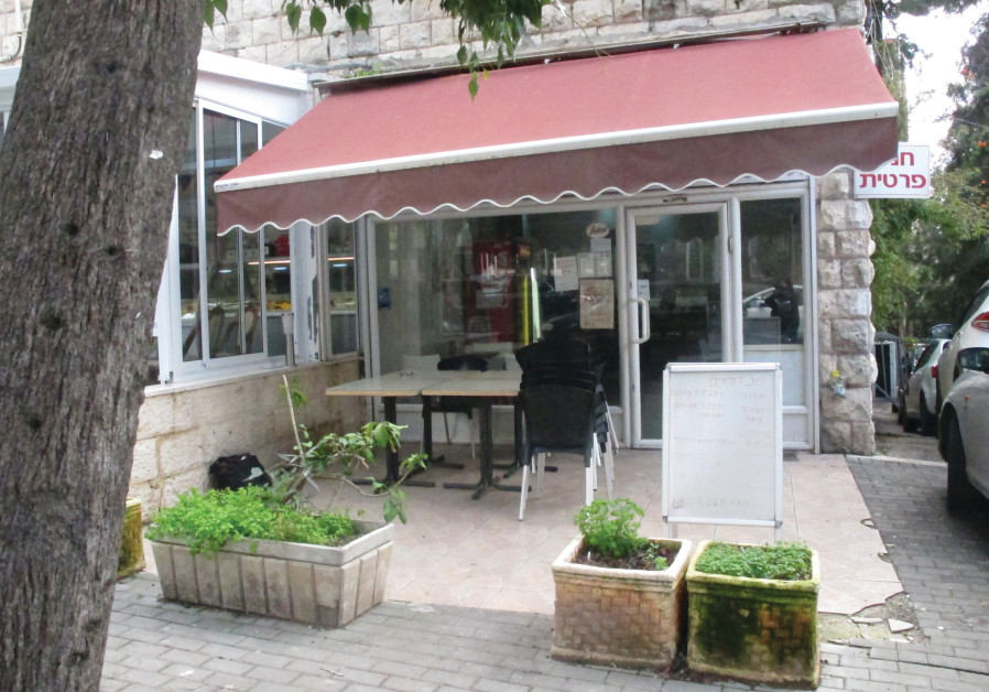 GIL'S PEOPLE-WATCHING patio is just right for a Jerusalem spring.
