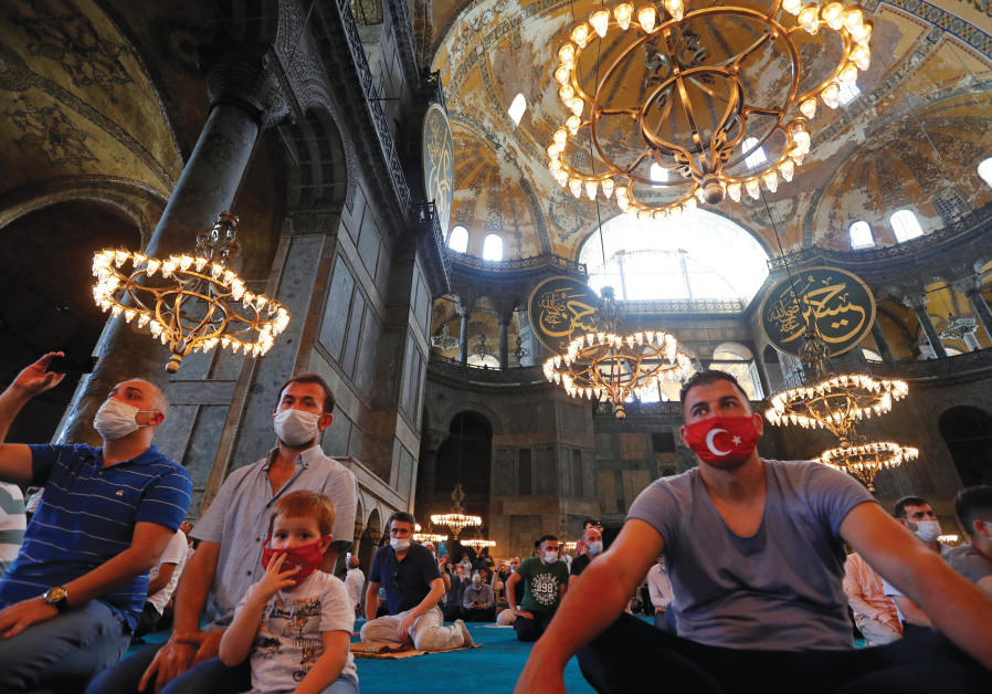 WORSHIPPERS TAKE part in afternoon prayers at Hagia Sophia, newly designated a mosque, in Istanbul on July 26. (Murad Sezer/Reuters)