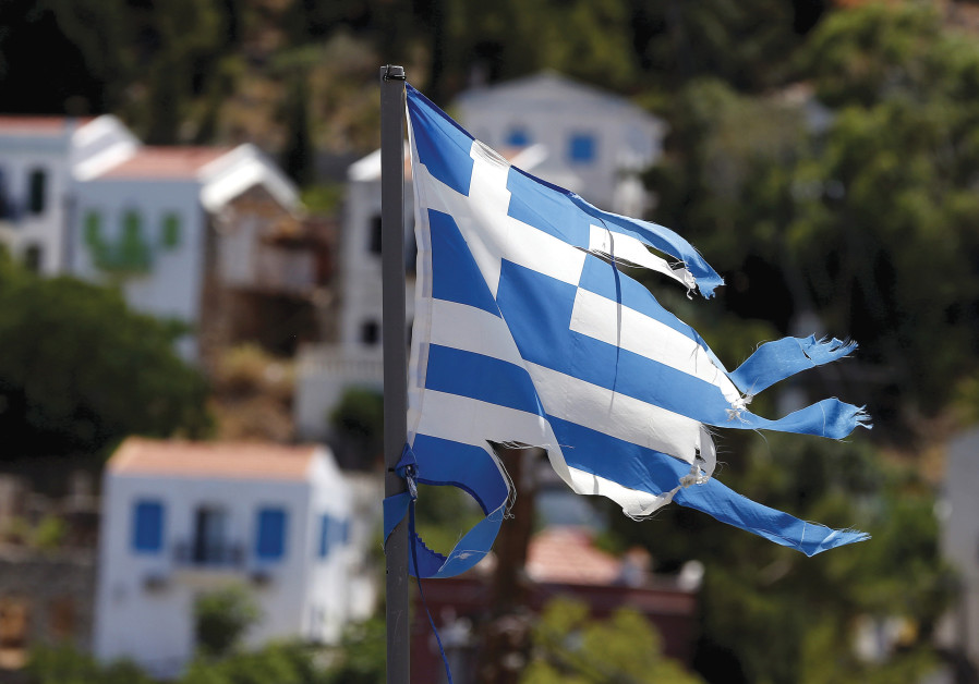 A TATTERED Greek flag flutters in the village of Meyisti on Kastellorizo. (Cathal McNaughton/Reuters)