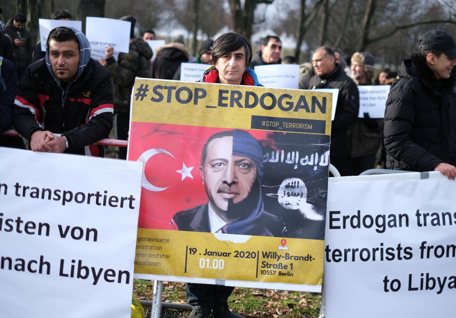 PROTESTERS RAIL against Turkish President Recep Tayyip Erdogan's participation in the Berlin summit on ending the conflict in Libya, on January 19. (Christian Mang/Reuters)