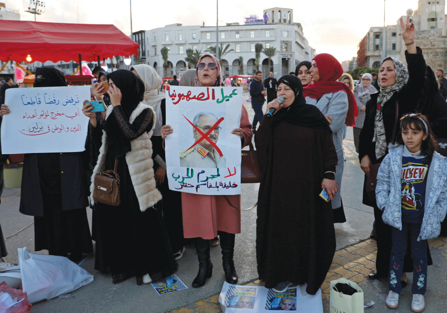 A LIBYAN woman displays a crossed-out picture of Gen. Khalifa Haftar during a demonstration demanding an end to his offensive against Tripoli, in the city's Martyrs' Square on December 27, 2019. (Ismail Zitouny/Reuters)