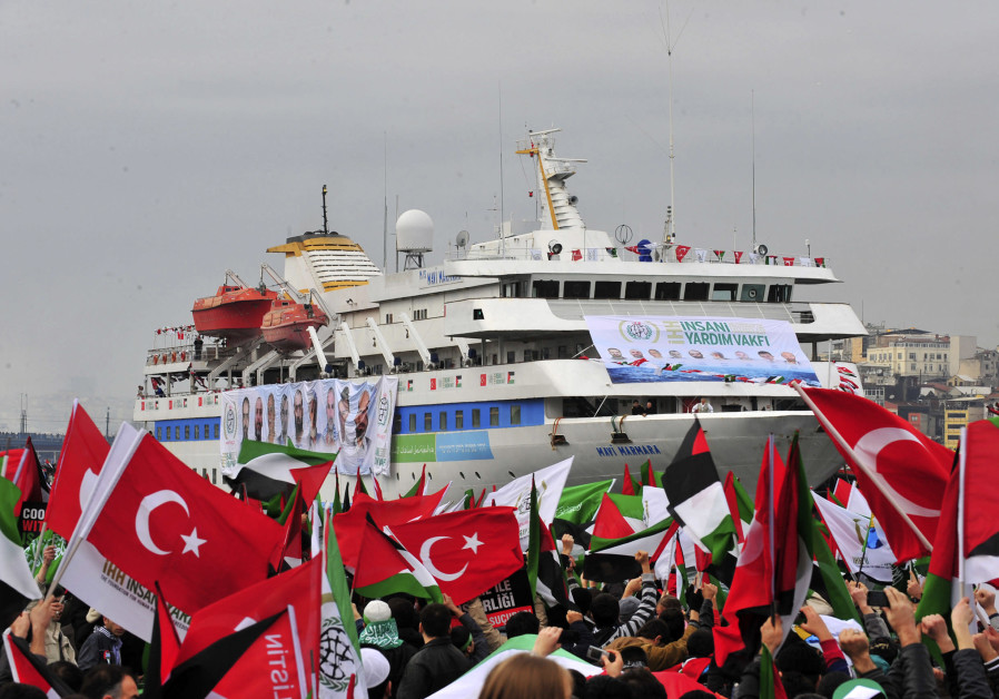 PRO-PALESTINIAN activists wave Turkish and Palestinian flags during the welcoming ceremony for the 'Mavi Marmara,' in Istanbul in December 2010. Nine Turkish activists died the previous May when IDF naval commandos stopped the ship. (Stringer/Reuters)