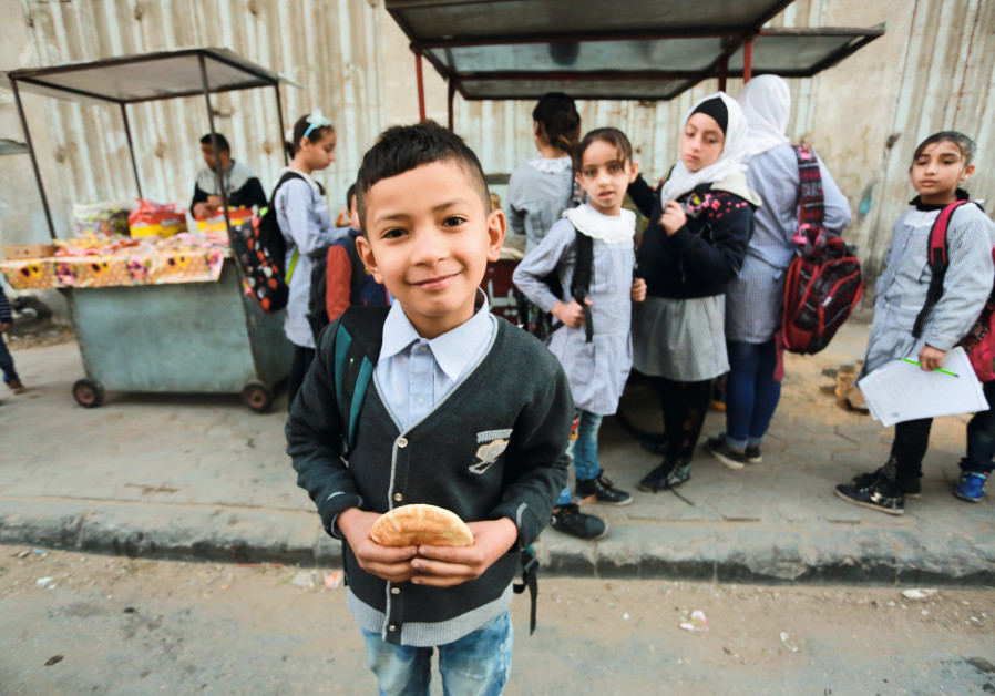 FALAFEL and hummus in a pita make for a healthy, affordable lunch for Gaza schoolchildren. (Mohammed Asad)