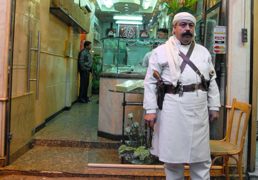 A WELL-GUARDED Damascus eatery. (Anonymous)