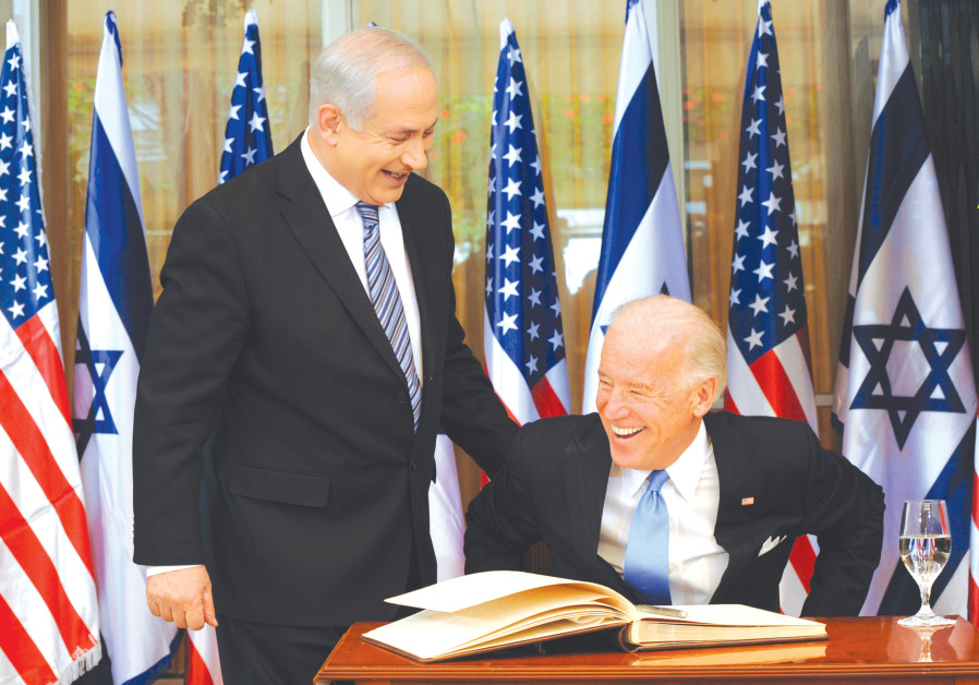 Prime Minister Benjamin Netanyahu laughs with then-vice president Joe Biden after he signed the guest book at the Prime Minister's Residence in Jerusalem on March 9, 2010 (DEBBIE HILL/POOL/REUTERS)