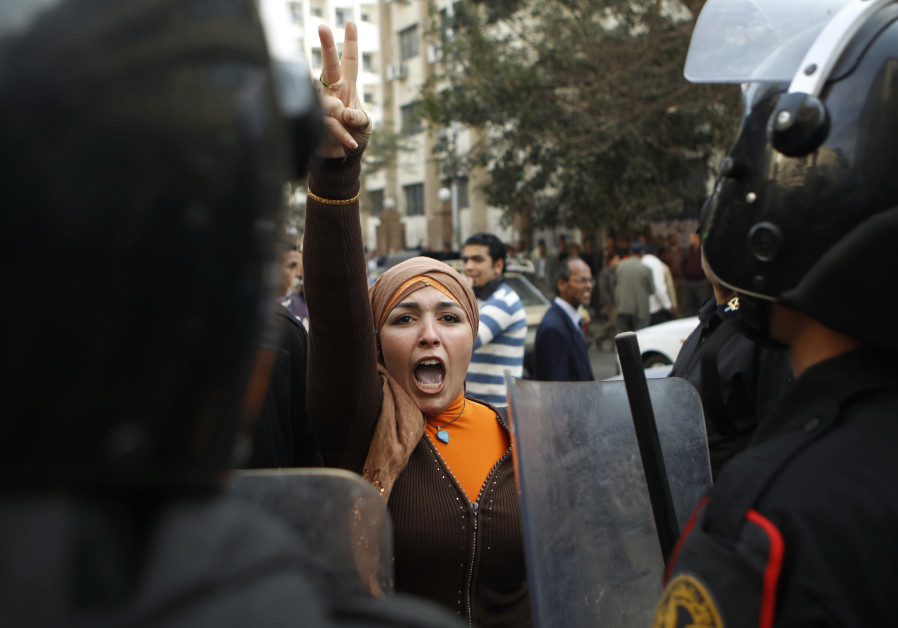 An anti-government woman protester gestures during clashes with police in Cairo on January 26, 2011 (AMR ABDALLAH DALSH/REUTERS)
