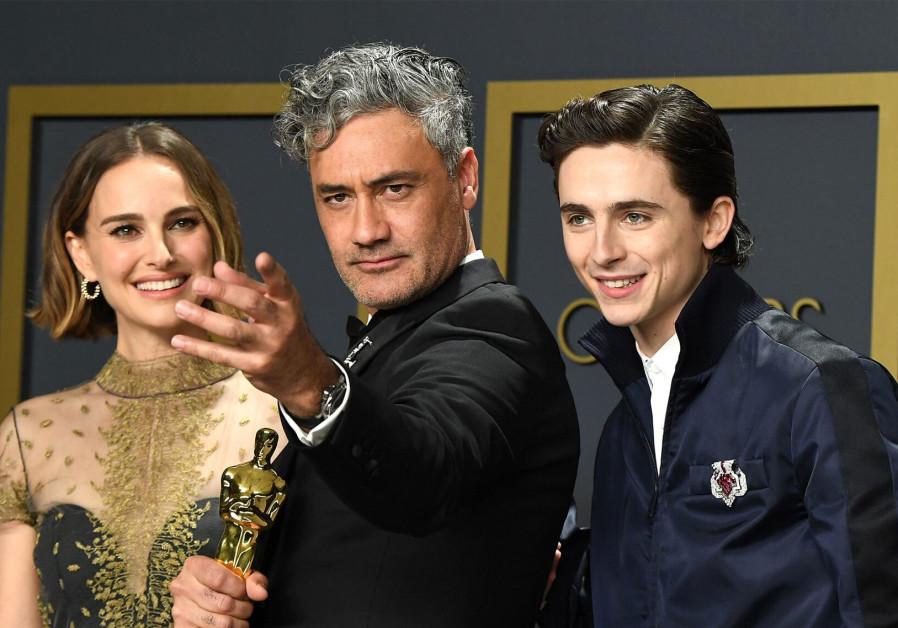 Maori Jewish director Taika Waititi with Natalie Portman [L] and Timothée Chalamet [R]./ STEVE GRANITZ/WIREIMAGE
