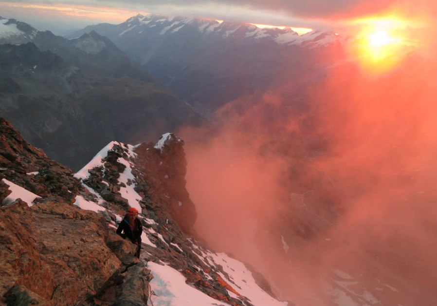 Sunrise on the way to summit    Photo credt: Yoram Kraus