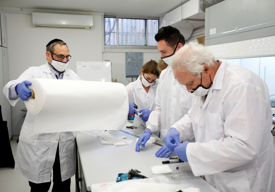 Employees of Israel's Sonovia Ltd, makers of washable and reusable antiviral masks, which the company says can help stop the spread of the coronavirus disease (COVID-19), work at their laboratory in Ramat Gan, Israel May 17, 2020/ Amir Cohen/Reuters
