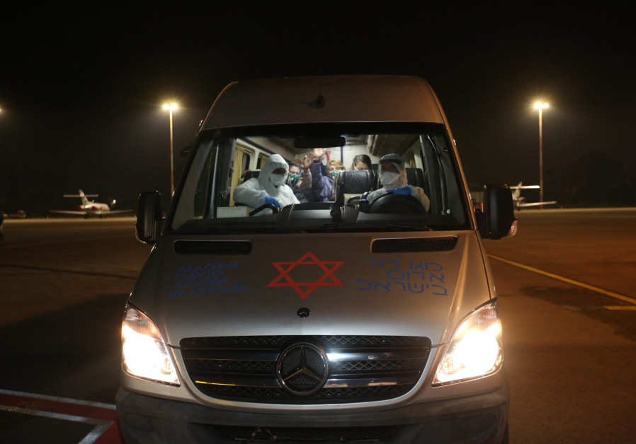 "Magen David Adom paramedic Rami Maushar escorts Israelis who were returning to the country after being quarantined on the Diamond Princess ""coronavirus"" ship for 14 days. (Magen David Adom)"