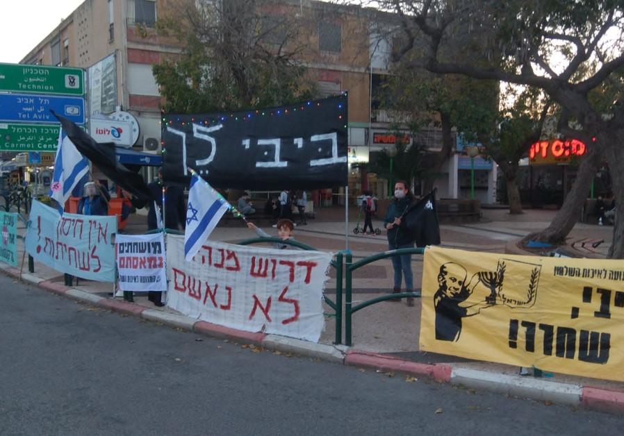 """Black Flag protesters in Haifa, one sign says """"There is no vaccination against corruption.""""/ Courtesy"""