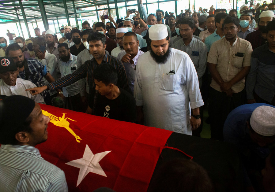 People attend at a funeral of U Khin Maung Latt, 58, a National League for Democracy (NLD)'s ward chairman in Yangon, Myanmar March 7, 2021. / Reuters