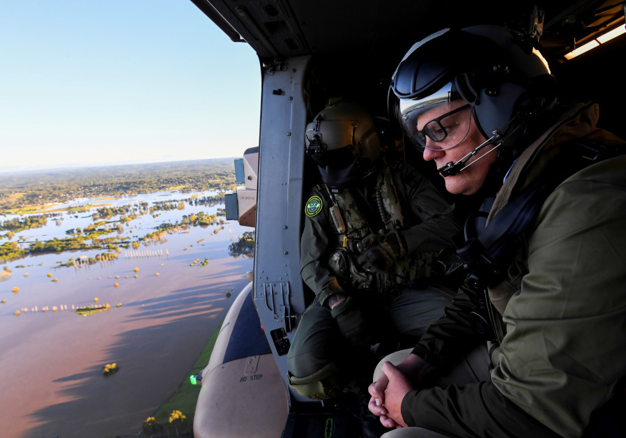Australian Prime Minister Scott Morrison inspects damage created by floodwaters from a helicopter during a visit to flood affected areas in Sydney, Australia, March 24, 2021./ REUTERS