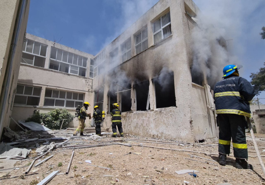 Smoke and flames rise after an Gaza rocket hit a school in Ashkelon. (Fire and Rescue)