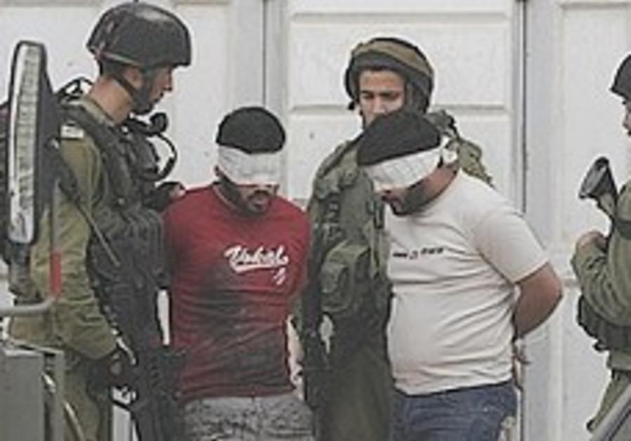 Troops arrest Palestinians 248.88