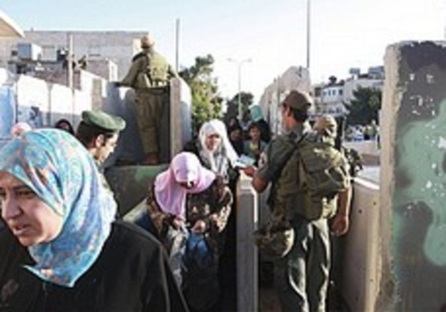 Border policeman checks Palestinians 248