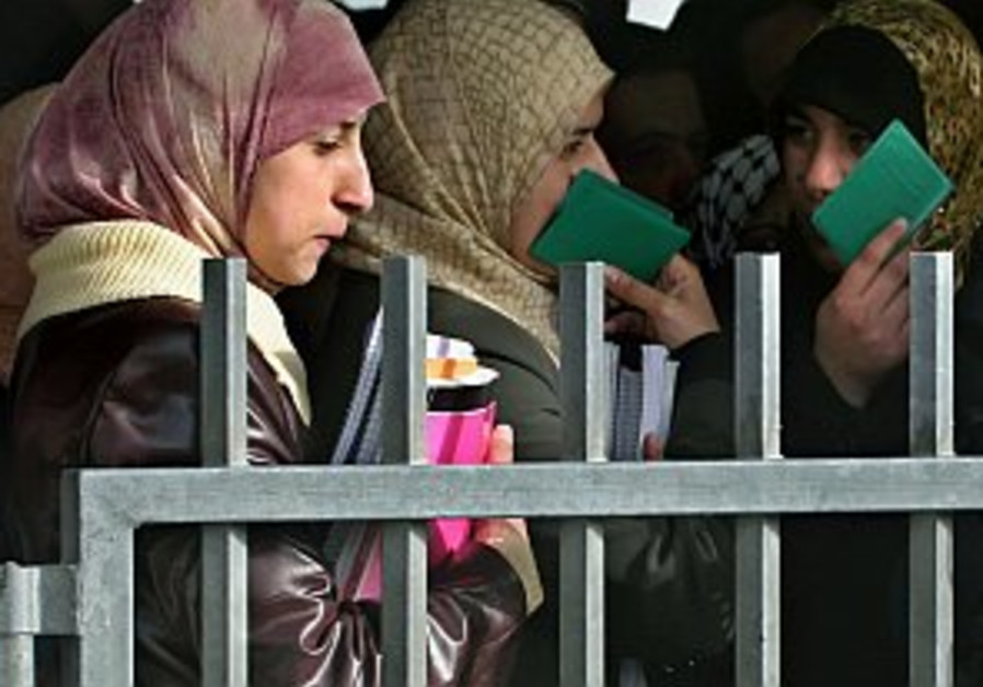 palestinian women wait at the hawara checkpoint 29