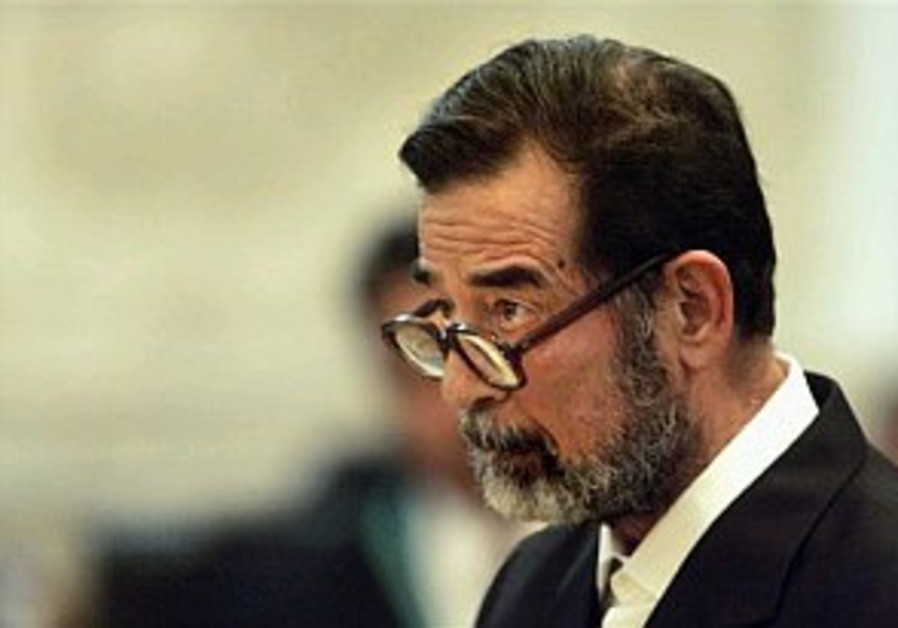 Saddam takes the stand for the first time