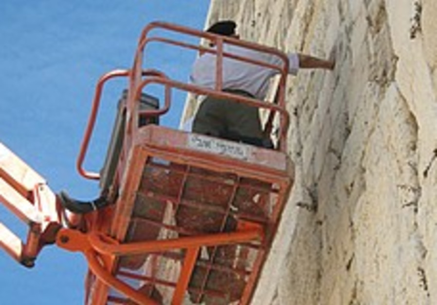 Workers reinforce stones of Western Wall