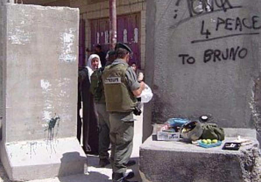 border police checking passage through sec. fence