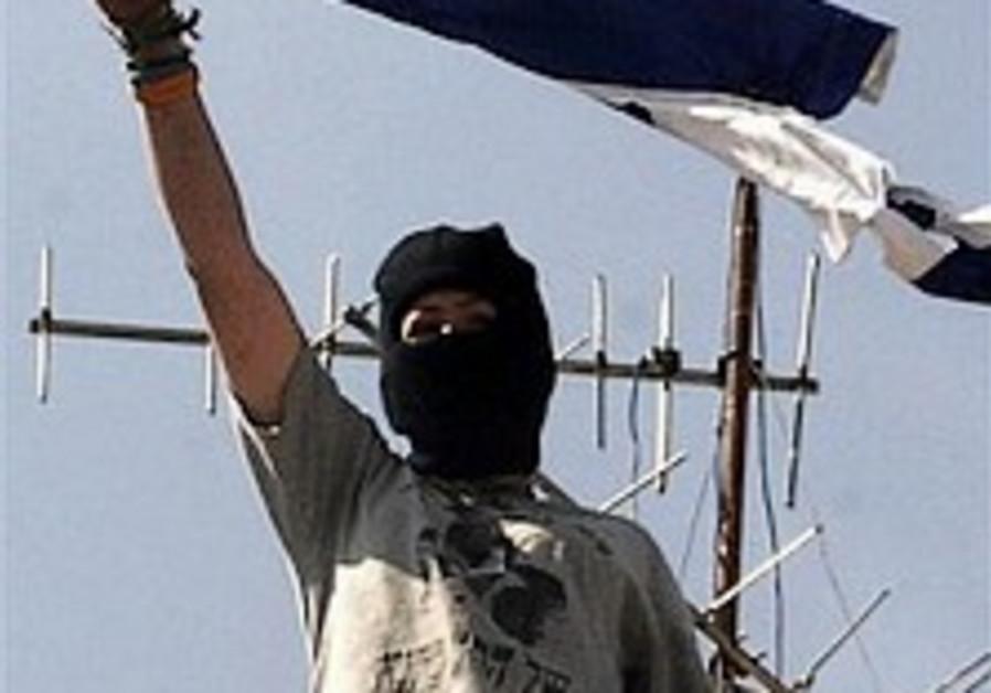 masked settler in hebron 298 ap