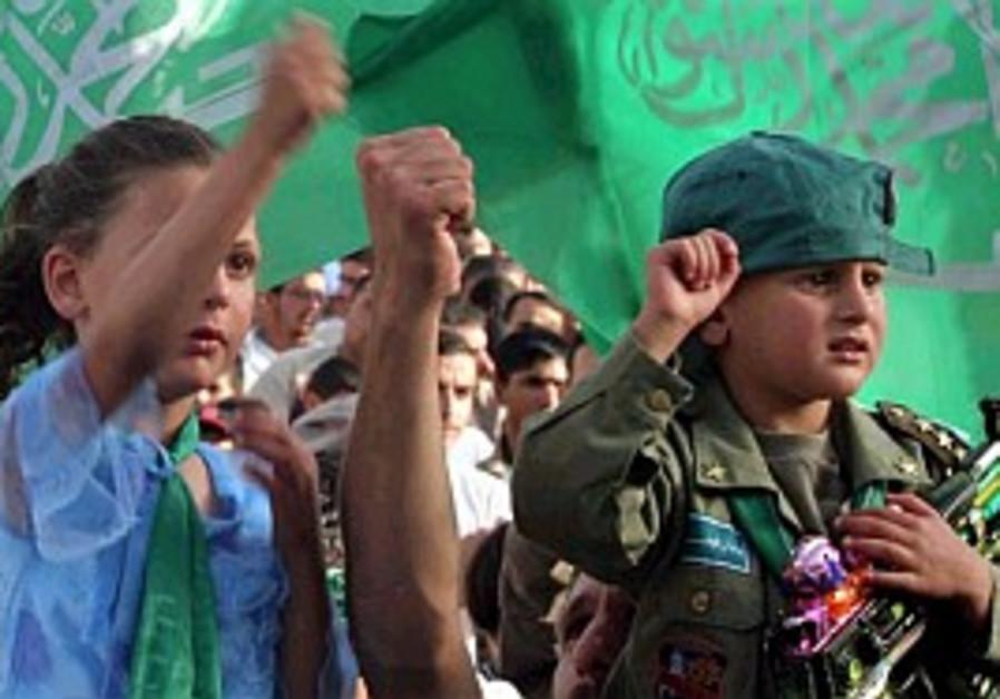 Kids brandish guns to test IDF vigilance