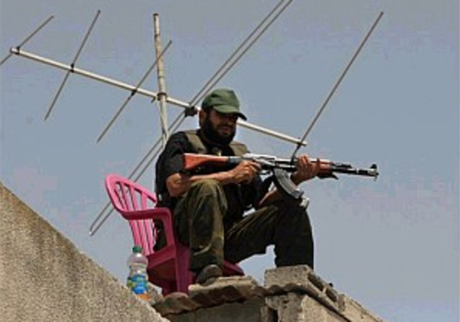 sitting with gun on rooftop