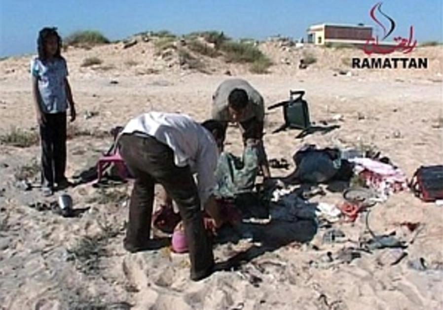 Gaza beach blast victim wakes