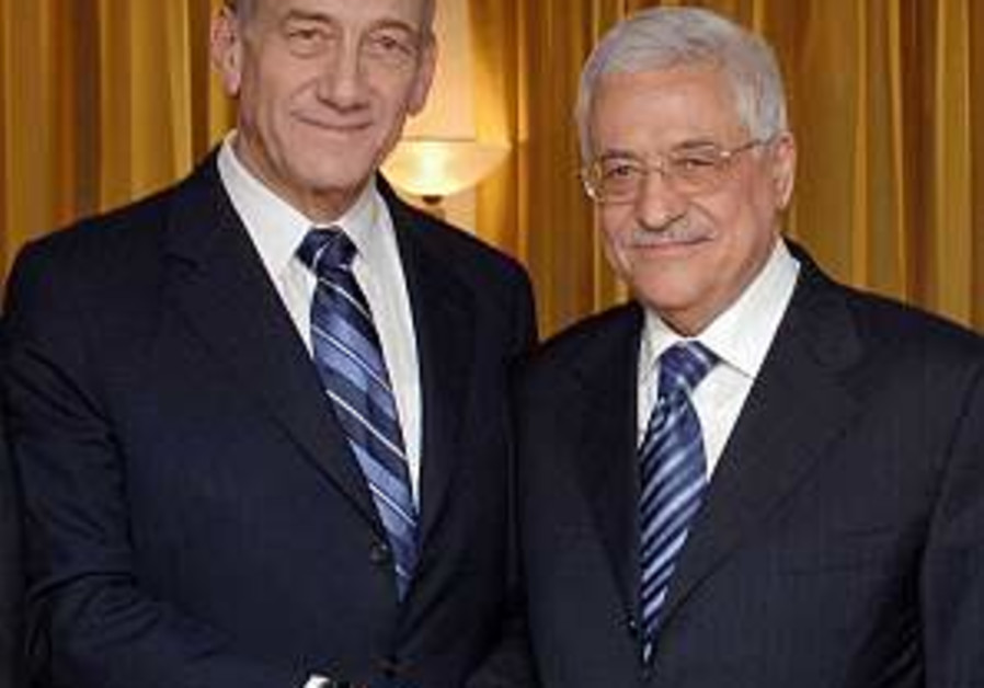 olmert and abbas shake hands in petra 298 gpo